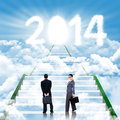 Two business people walks on the ladder walking leading upward to new year Stock Photos
