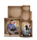 Two business people working cardboard boxes empty spaces above them entrepreneur concept Royalty Free Stock Photos