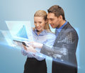 Two business people working with virtual screen Stock Photo