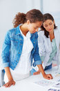 Two business woman working on a project together Royalty Free Stock Photography