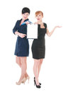 Two business women with blank holding in hands over white background Stock Photography