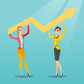 Two business women holding growth graph.