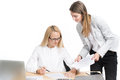 Two business women talking and signing document happy Royalty Free Stock Image