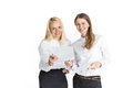 Two business women talking and signing document happy Stock Photos