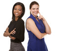 Two business women wearing office outfits on white isolated background Royalty Free Stock Image