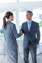 Two business workers shake hands Royalty Free Stock Photo