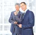 Two businessmen conclude a deal in the office Royalty Free Stock Photos