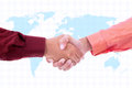 Two businessmen handshaking world map background Stock Image