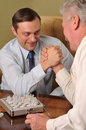 Two businessmen have fun Royalty Free Stock Image