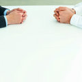 Two businessmen having a discussion closeup image of their hands on the table Royalty Free Stock Photos