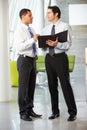Two Businessmen Having Informa...
