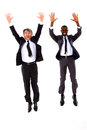 Two businessmen jumping Stock Photos