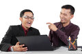 Two businessmen laughing young asian while having a conversation on white background Royalty Free Stock Images