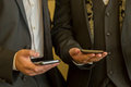 stock image of  Two businessmen with mobile phones. People with contemporary mobile phones