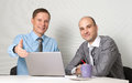 Two businessmen in office Stock Images