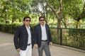 Two businessmen in park business men friends black suit standing wearing sunglass Royalty Free Stock Photography