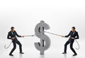 Two businessmen pulling big concrete d dollar sign with ropes in opposite directions isolated on white background rivalry and Stock Photos