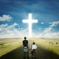 Two businessmen on the road with a cross standing while looking at Royalty Free Stock Images