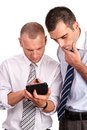 Two businessmen in shirts looking down with concern and consult consulting the latest results news on a digital tablet isolated on Stock Photography