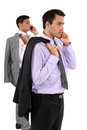 Two businessmen stood taking on their mobile telephones Royalty Free Stock Photo