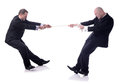 Two businessmen tug war isolated white background Stock Images