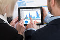 Two Businesspeople Analyzing Graph On Digital Tablet Royalty Free Stock Photo