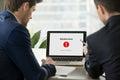 Two businessmen looking at broken laptop, operating system crash Royalty Free Stock Photo