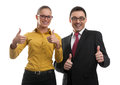 Two businesspeople showing their thumbs up isolated on white Stock Photo