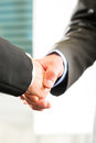 Two businessperson shaking hands closing deal closeup Stock Photos