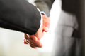 Two businessperson shaking hands closing deal closeup Royalty Free Stock Image