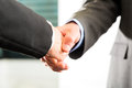Two businessperson shaking hands closing deal closeup Royalty Free Stock Photography