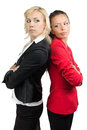 Two businesswoman standing back to back business women Stock Image