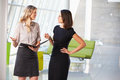 Two Businesswomen Having Informal Meeting In Modern Office Royalty Free Stock Images