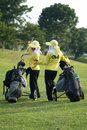 Two caddies at a golf course Royalty Free Stock Photo