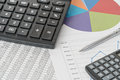 Two calculator and graphs Royalty Free Stock Photo