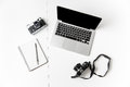 Two cameras notepad with pen and blank screen laptop top view of isolated over white background Stock Image