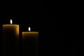 Two candles with dark background Royalty Free Stock Photo