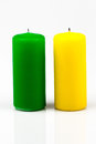 Two candles of different colors on a white background Royalty Free Stock Photos