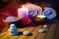Two candles towels camellias stones salt massage Stock Photography