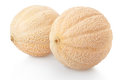 Two cantaloupe melons on white Royalty Free Stock Photo
