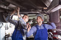 Two car mechanics at workshop Royalty Free Stock Photo