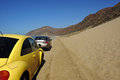 Two cars parked close to mountains and desert at malibu area in california usa Royalty Free Stock Photography