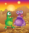 Two cartoon alien creatures on a background of ali planet landscape with three suns Stock Photography