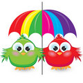 Two cartoon sparrow under the colorful umbrella Royalty Free Stock Photography