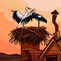 Two cartoon storks in the nest on the roof of the house