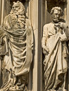Two Carved Religious Marble statues Stock Image