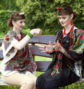 Two caucasian slavonic women sitting on the bench wooden in garden Royalty Free Stock Photos