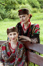 Two caucasian slavonic women sitting on the bench Royalty Free Stock Photo