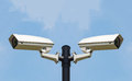 Two CCTV Security camera on clear sky Royalty Free Stock Photo