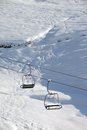 Two chair lift with snowdrift and off piste slope in sun morning caucasus mountains georgia ski resort gudauri Royalty Free Stock Photo